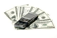 Concepto del teléfono móvil y del dólar Fotos de archivo