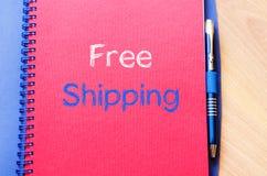 Concepto del texto del envío gratis en el cuaderno imagenes de archivo