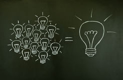 Concepto del trabajo en equipo de las bombillas imagenes de archivo