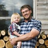 Concepto del tronco de Kid Leisure Firewood del padre Foto de archivo libre de regalías