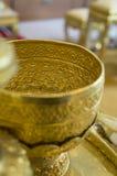 Concepto del utensilio del hogar del oro del arte del envase de la antigüedad de Goldware Imagenes de archivo