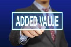 Concepto del valor añadido Foto de archivo libre de regalías