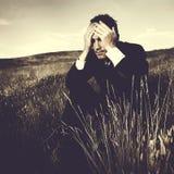 Concepto deprimido de Stress Failure Lonely del hombre de negocios imagen de archivo