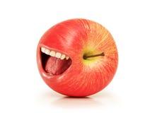 Concepto divertido con la manzana y la boca rojas Imagenes de archivo