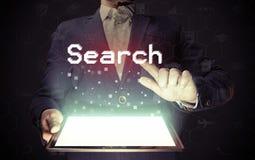Concepto en línea de la búsqueda foto de archivo