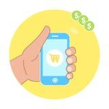 Concepto en línea de las compras con la mano que lleva a cabo iconos de la cesta del smartphone y del comercio electrónico Fotos de archivo