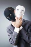 Concepto industrial del espionate - hombre de negocios enmascarado Foto de archivo libre de regalías