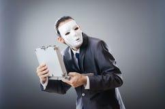 Concepto industrial del espionate - hombre de negocios enmascarado Foto de archivo