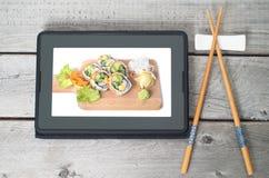 Concepto japonés en línea de la entrega de la comida imágenes de archivo libres de regalías