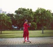 Concepto juguetón de la diversión linda de la felicidad del muchacho del super héroe Foto de archivo libre de regalías