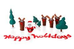Concepto, juguetes de la Navidad Papá Noel con el árbol del reno y de abeto en nieve Fotografía de archivo