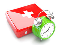 Concepto médico con el kit del reloj y de primeros auxilios Imagen de archivo libre de regalías