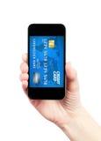 Concepto móvil del pago en el iPhone de Apple Fotografía de archivo libre de regalías