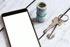 Concepto móvil del uso de las propiedades inmobiliarias imágenes de archivo libres de regalías