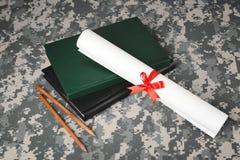 Concepto militar de la educación Libros, lápices Foto de archivo libre de regalías