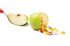 Concepto natural de las píldoras de la dieta Foto de archivo libre de regalías