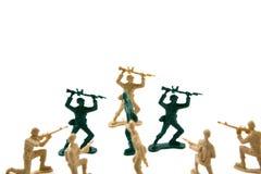 Concepto obstinado - ArmyMmen plástico fotos de archivo