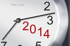 Concepto 2014, primer del Año Nuevo del reloj en el fondo blanco. Imágenes de archivo libres de regalías