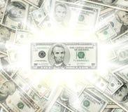 Concepto que brilla intensamente de los billetes de banco del dólar Foto de archivo