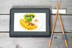 Concepto que ordena de la comida asiática en línea Fotografía de archivo