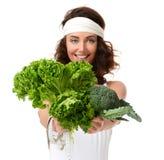 Concepto sano de la consumición dieting Bróculi de la lechuga del control de la mujer y imagen de archivo