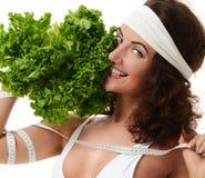Concepto sano de la consumición dieting Bróculi de la lechuga del control de la mujer y fotos de archivo