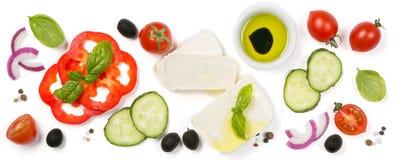 Concepto sano de la consumición - selección de ingredientes griegos de la ensalada en el fondo blanco fotos de archivo libres de regalías