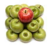Conceptos de la dominación con las manzanas Imagen de archivo libre de regalías