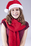 Conceptos e ideas dentales del tratamiento Adolescente caucásico en Santa Hat With Teeth Brackets contra blanco Fotos de archivo