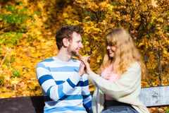 Lovers couple in autumn park on bench Stock Photo