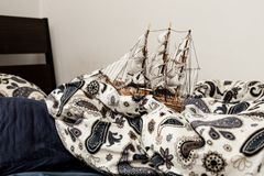Concepts of business and creativity. model of a sailing ship in a blue bedding. symbolism and abstraction royalty free stock photos