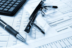 Concepts business finance. A calculator, pen, and financial statement royalty free stock photos