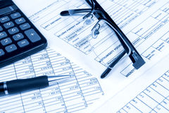 Concepts business finance. A calculator, pen, and financial statement stock photo