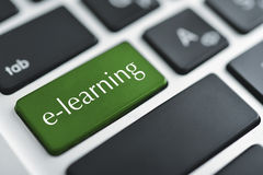 Concepts of E-learning. For computer based learning, with a message on enter key of keyboard Royalty Free Stock Photos