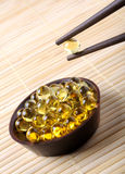 Concepts: fish oil capsules Stock Photography