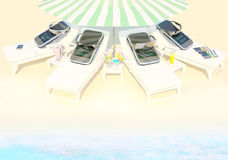 Concepts and ideas; Phones lie on chaise lounges on the beach. At the sea. Beach. Rest. Phones lie on chaise lounges on the beach stock images