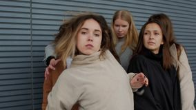 Concepts making their way through social danger. Female students infringe upon a girl. Concepts social danger or unfortunate victim. Young woman making their way stock video footage