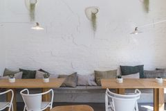 Free Concepts Of Interior Spaces On White Brick Wall Tables And Chairs With Floral Decoration Stock Photo - 160186360