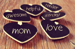 Concepts referring to a good mom, such as love, helpful or tende. Some heart-shaped blackboards with concepts referring to a good mom written in them, such as Royalty Free Stock Photos