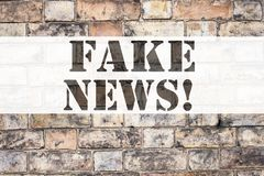 Conceptual announcement text caption inspiration showing Fake News. Business concept for Propaganda Newspaper Fake News written on. Old brick background with Stock Photos