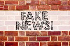 Conceptual announcement text caption inspiration showing Fake News. Business concept for Propaganda Newspaper Fake News written on. Old brick background with Royalty Free Stock Images