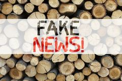 Conceptual announcement text caption inspiration showing Fake News Business concept for Propaganda Newspaper Fake News written on. Wooden background with space Royalty Free Stock Images