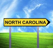 Conceptual arrow sign against beautiful landscape with text - NORTH CAROLINA stock photos