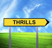 Conceptual arrow sign against beautiful landscape with text - THRILLS royalty free stock images