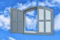 Conceptual art: grey window left ajar on blue sky Stock Photography