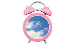 Conceptual art time to relax : sky and cloud within pink alarm clock isolated on white background Stock Photography