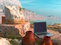 conceptual background with antique column and laptop Royalty Free Stock Photo