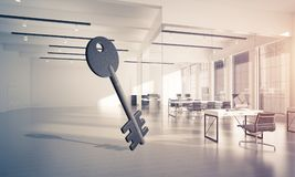 Conceptual background image of concrete key sign in modern offic. Key stone figure as symbol of access in elegant office room. 3d rendering Stock Photo