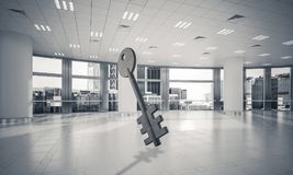 Conceptual background image of concrete key sign in modern offic. Key stone figure as symbol of access in elegant office room. 3d rendering Stock Images