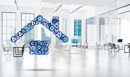 Real estate or construction idea presented by home icon on white office background. Conceptual background image with house sign made of connected gears. 3d Stock Photo